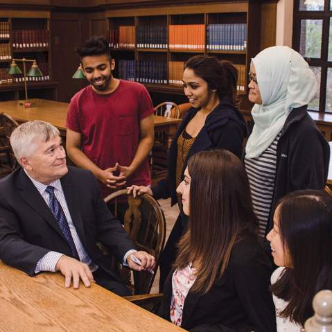 President Eric Barron with students at the library