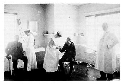 Dr. Joseph P. Ritenour. with nurses and patients in the infirmary