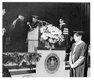 George H. Deike presenting the University mace to Eric Walker at his 1956 inaugural.