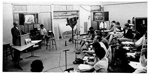 Teacher with television in classroom