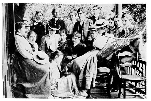 old black and white photograph of students on  porch