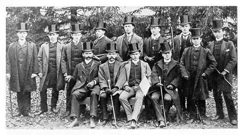 old black and white photograph of men in top hats
