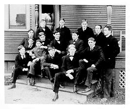 old black and white photograph of men posing on steps