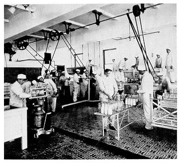 old black and white photograph of students working in the creamery