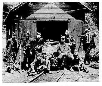 old black and white photograph of Mining engineering at mine entrance