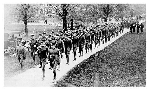 old black and while photgraph of students marching in military uniforms