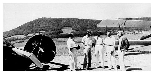 old black and white photograph of Sherman Lutz and student pilots at Oak Hall air depot.