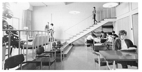 old black and white photograph of students studying inside North Hall lounge
