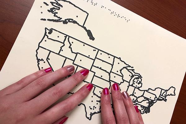 Blind student studies map using raised lines