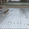 Interior Courtyard Welding of Metal Decking on Roof